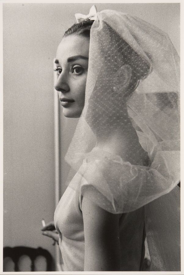 Audrey Hepburn in a wedding dress with cigarette on the set of ...