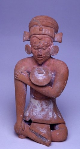 Whistle in the form of a seated male