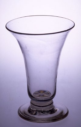 Syllabub glass clear in color; short stem; round foot; flared lip