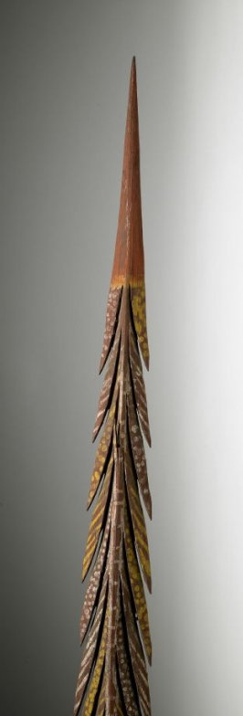 Spear with red handle and twenty six spikes with dots and stripes