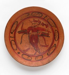 Footed plate with dancing Maize God