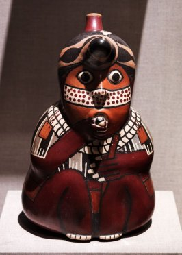 Stirrup spouted vessel with ceremonial figure