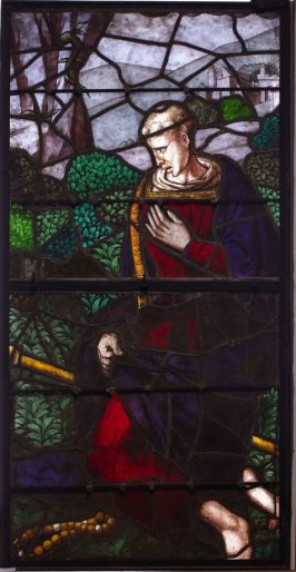 Stained glass window: A Saint kneeling with a rosary