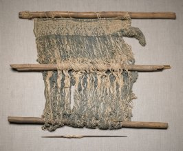 Loom parts with weaving in place