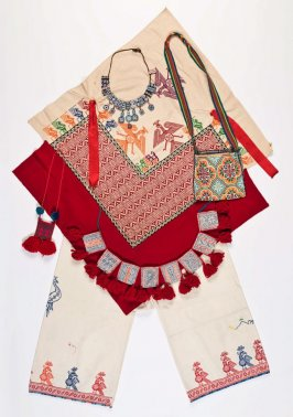 Ensemble: (a) cape, (b) pants, (c) embroidered bag, (d) pocket belt, (e) beaded necklace, (f) woven bag (in five pieces), and (g) bag