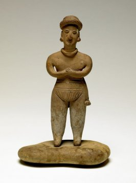 Standing Male Figure on Stone