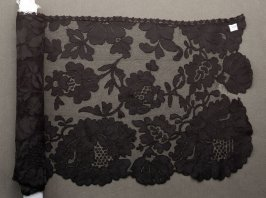 Flounce black, with bouquet design and scalloped border