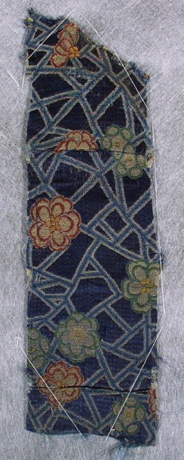 Textile fragment (may match 54687.241)