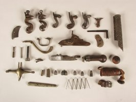 Wooden box full of various metal gun and armor parts. THERE ARE TWO RECORDS WITH THIS NUMBER