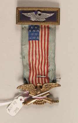 Badge with two eagles and American flag
