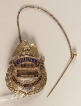 Badge: Foreman, S.F.F.D. Hook and Ladder Co. #4, presented to James W. Kentzell blue and black