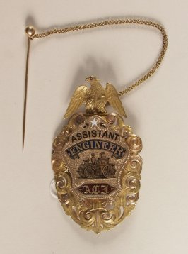 Assistant Engineer's badge of A.C. Imbrie form Hook and Lad-der Co. #1 in form of a shield