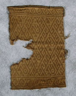 Bag front fragment brown and beige diamond pattern