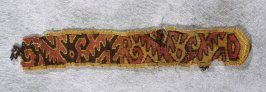 Fragment of a band or tab