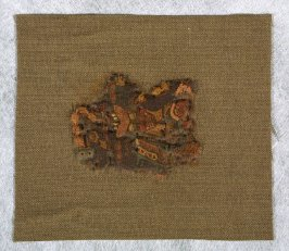Fragment: brown, beige with red fringe