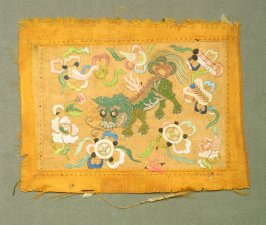 Embroidery blue and green foo dog and flowers on gold