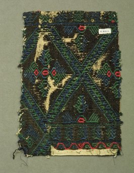Fragment: of embroidery, all over design brown lozenges with blue and green lattice framing