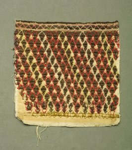 Fragment : of embroidery, allover pattern of brown lozenges, outlined with red/white or pale yellow