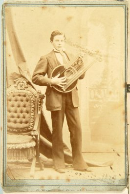 "Photograph of young man playing ""The Vocal Zither"""