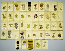 Forty three souvenir badges, pins, fobs, and pendants
