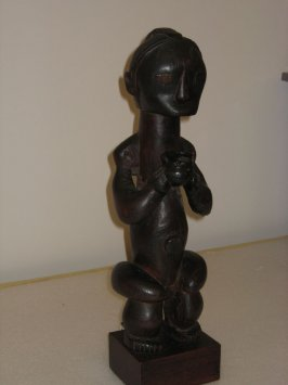Seated female figure holding vessel