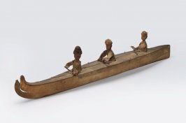 Bidarka model with three figures