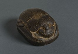 Scarab showing sun-god Khepri rising from his barque