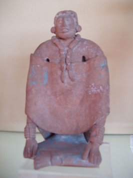 Whistle in the form of a seated female figure