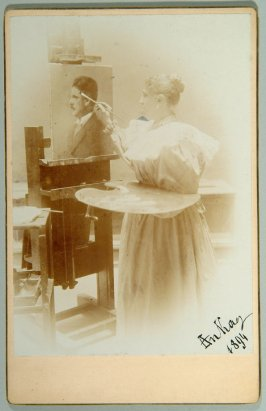 autographed photograph of woman painting portrait