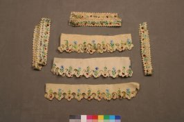 Fragment :eight borders of multi colored floral on scalloped saw toothfelt band (unmeasurable)