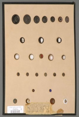 Board with 27 buttons attached all have woman's faces