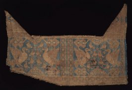 Fragment of a saddle cover
