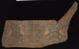 Fragment from a saddle cover