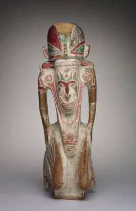 Tami-style standing figure with red headdress