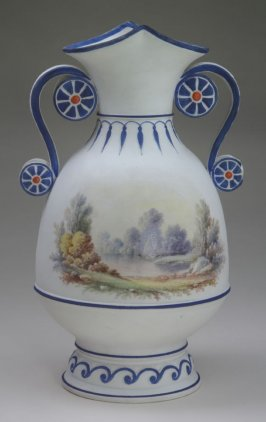 White urn with blue borders and sailboat
