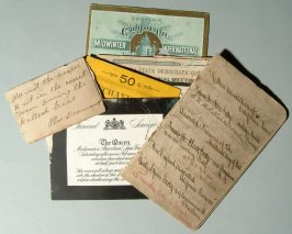 various souvenir admission tickets and a journal