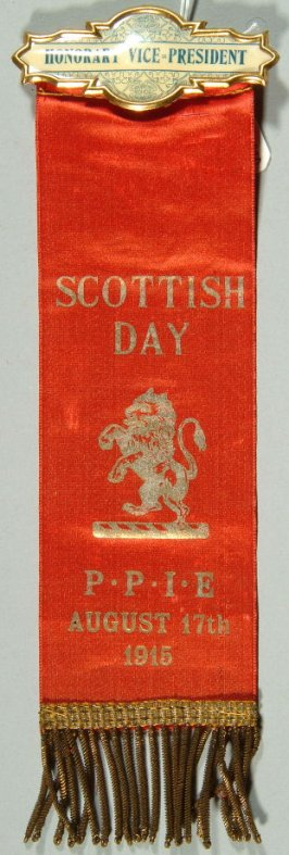 "Ribbon: ""Scottish Day, P.P.I.E."" red; with rampant lion"