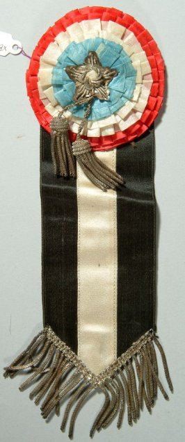 Badge of the G.A.R. worn by Thomas Mallon red, white, and blue circles, with silver tassels