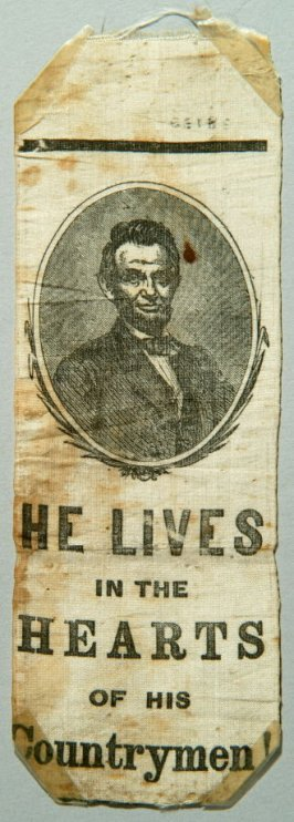 """Mourning ribbon for Abramham Lincoln: """"He Lives in the Hearts of His Countrymen"""""""
