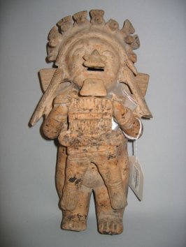 Figure with bird headdress
