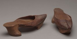 Pair of high-heeled clogs