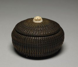 Lidded basket with carved seal head