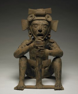 Seated Male Figure with Pole