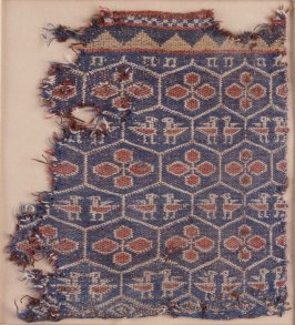 Textile fragment depicting flowers and confronted birds in a tortoise-shell lattice