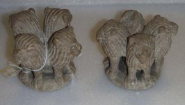 Pair of finials in the form of adorned lions