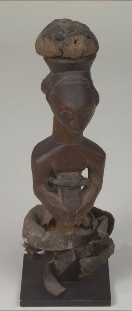 Figure with Bundle on Head