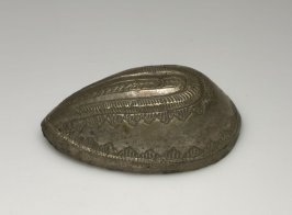 Metal covered egg-shaped object