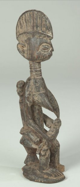 Seated Female Figure with Two Children