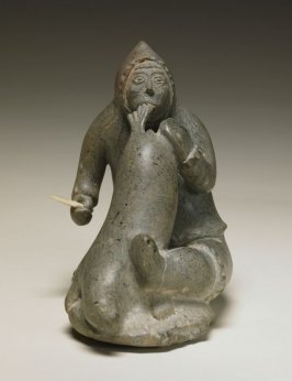 Seated Hunter with Seal Flipper in Mouth, Knife in Hand