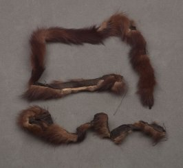 Two fragments brown fur trim with cloth backing